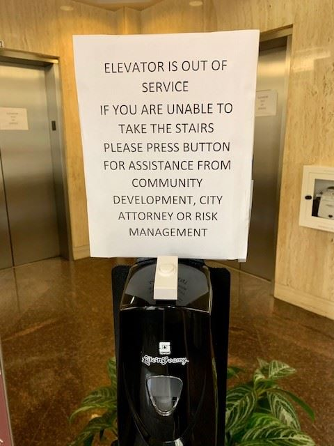 Photo of a sign about the CIty Hall Elevators being out of service